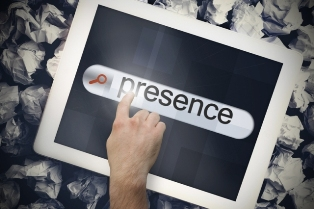 This image shows a hand pressing the word 'presence' on a search bar displayed on a tablet computer screen.