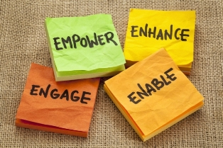 This graphic features four coloured Post-It notepads labelled with tips for creating content to suit your target audience: 'empower', 'enhance', 'engage' and 'enable'